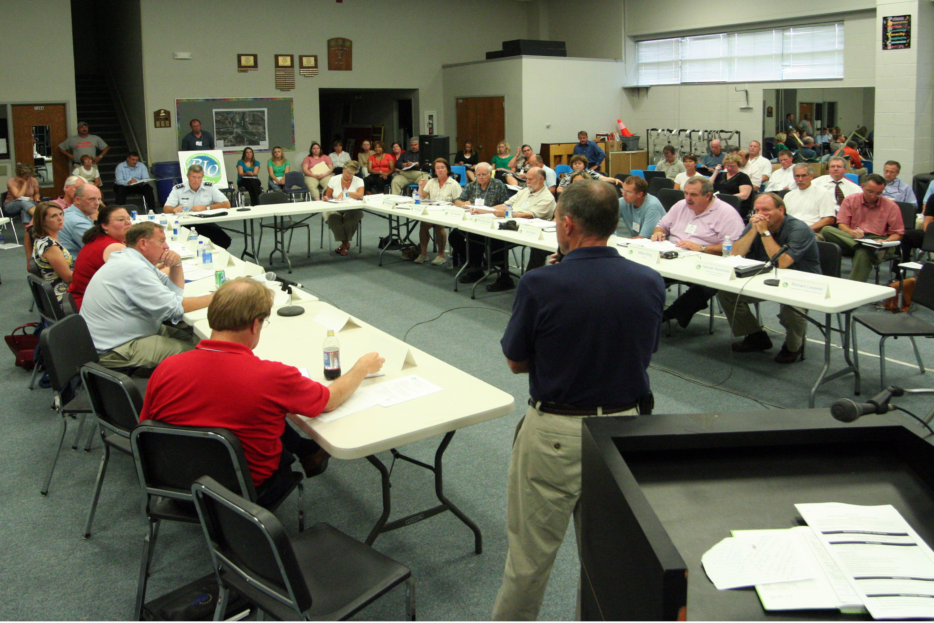"Wapello, IA, Auguawt 5, 2008 -- Federal Coordinating Officer Bill Vogel attended today's ""Rebuilding Iowa"" meeting at Wapello High School to update community leaders on FEMA's progress in providing temporary housing for displaced Iowans. Governor Culver started the ""Rebuilding Iowa Office"" to hasten recovery after a series of storms in May and June decimated the state. Photo by Greg Henshall / FEMA"
